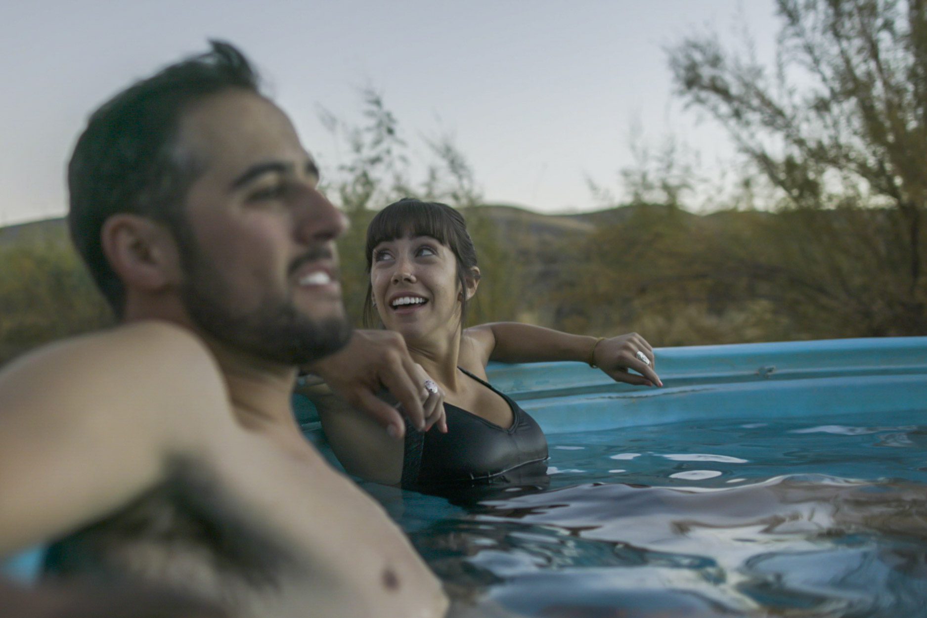 Couple Laughing in Hot Springs