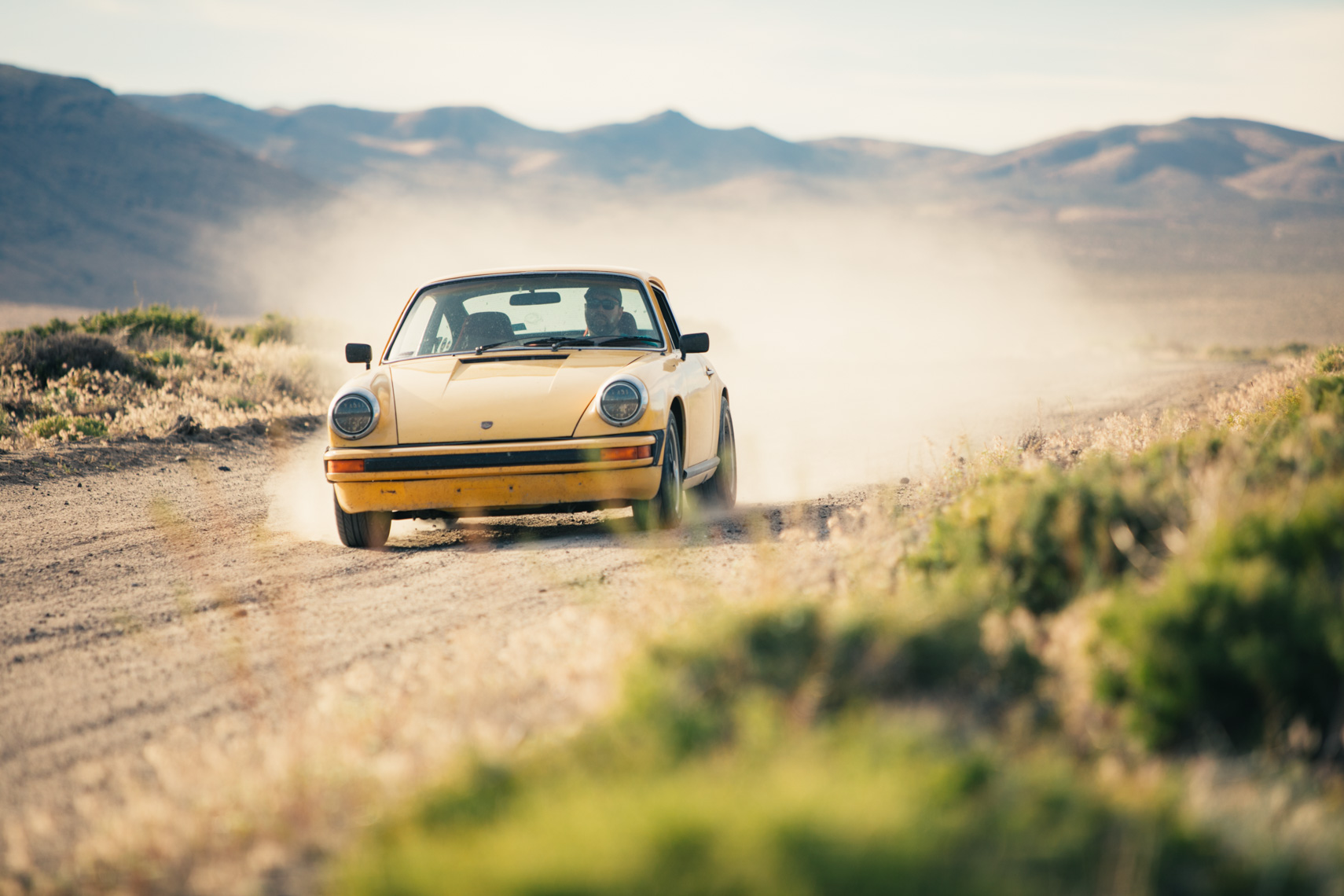 Porsche Driving On Dirt Road