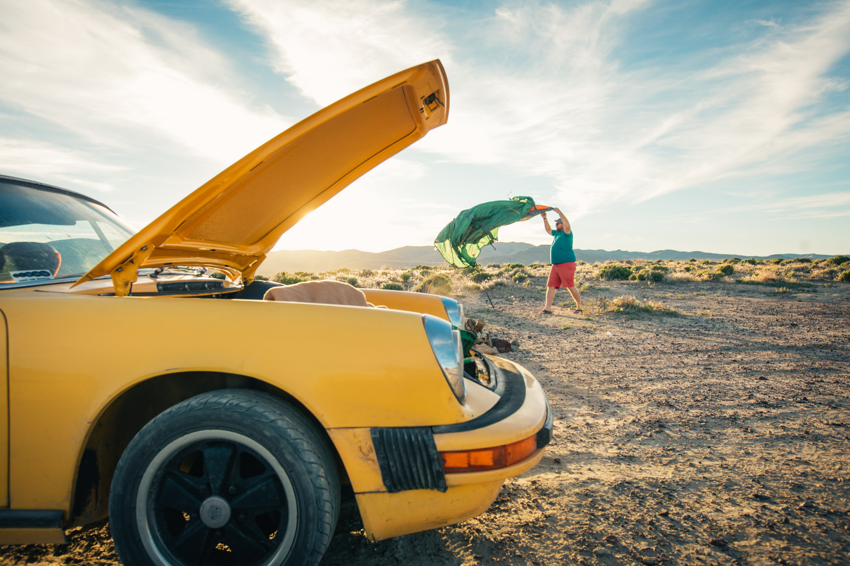 Man With Porsche in Desert