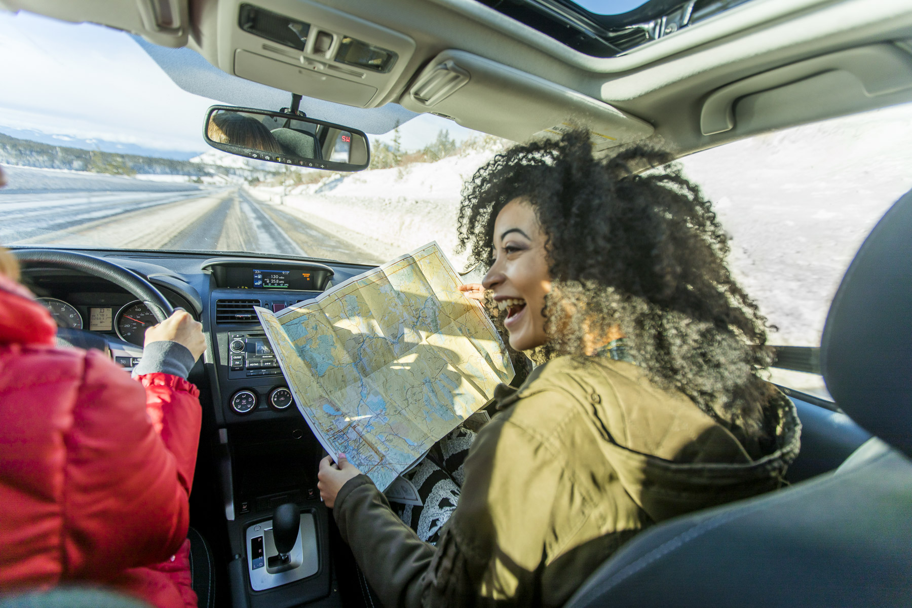 2 Girls with map in Subaru Outback