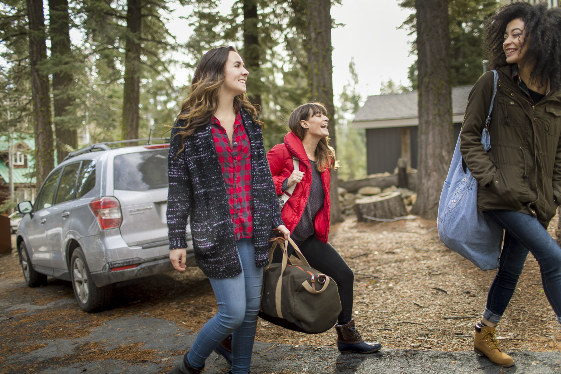 3 Girls Laughing Carrying weekend bags