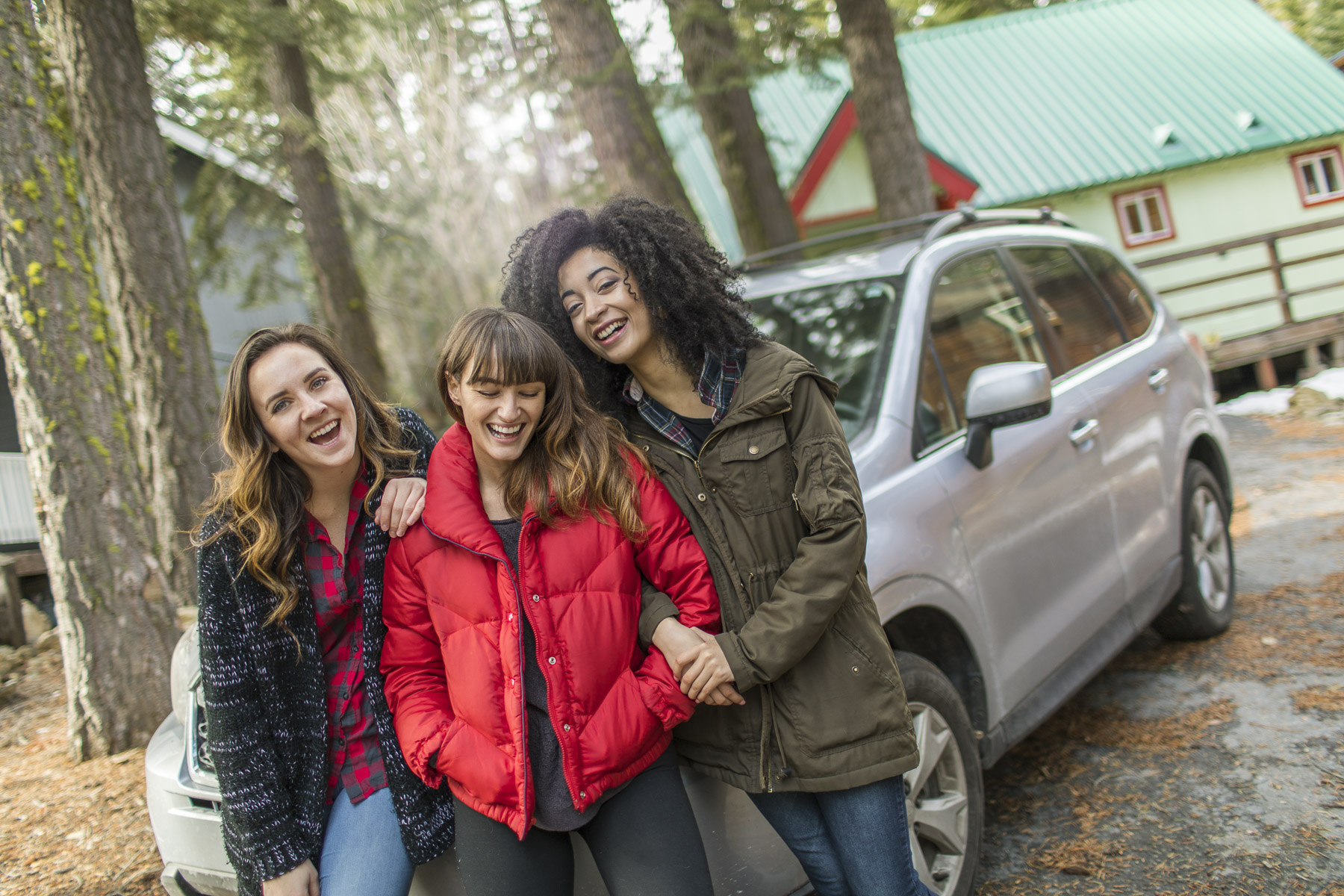 3 Girls Laughing on hood of car