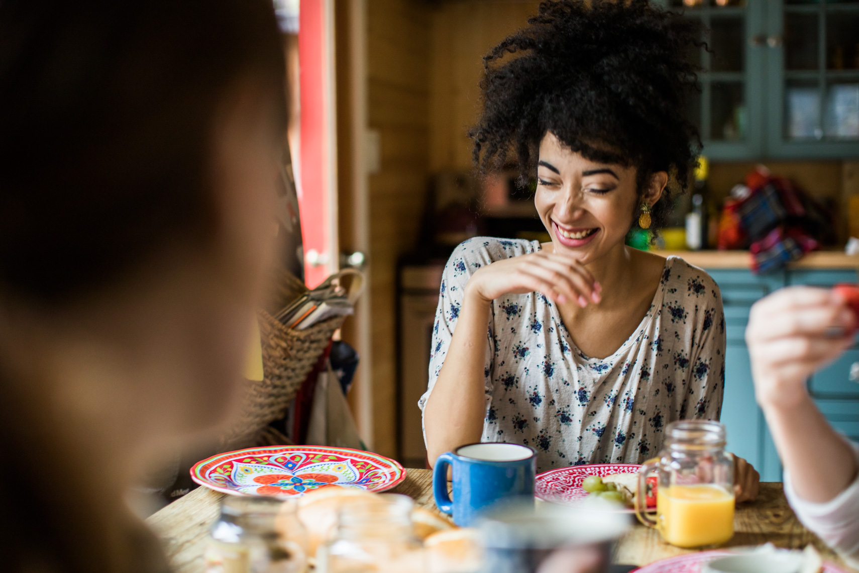Young Woman laughing at breakfast