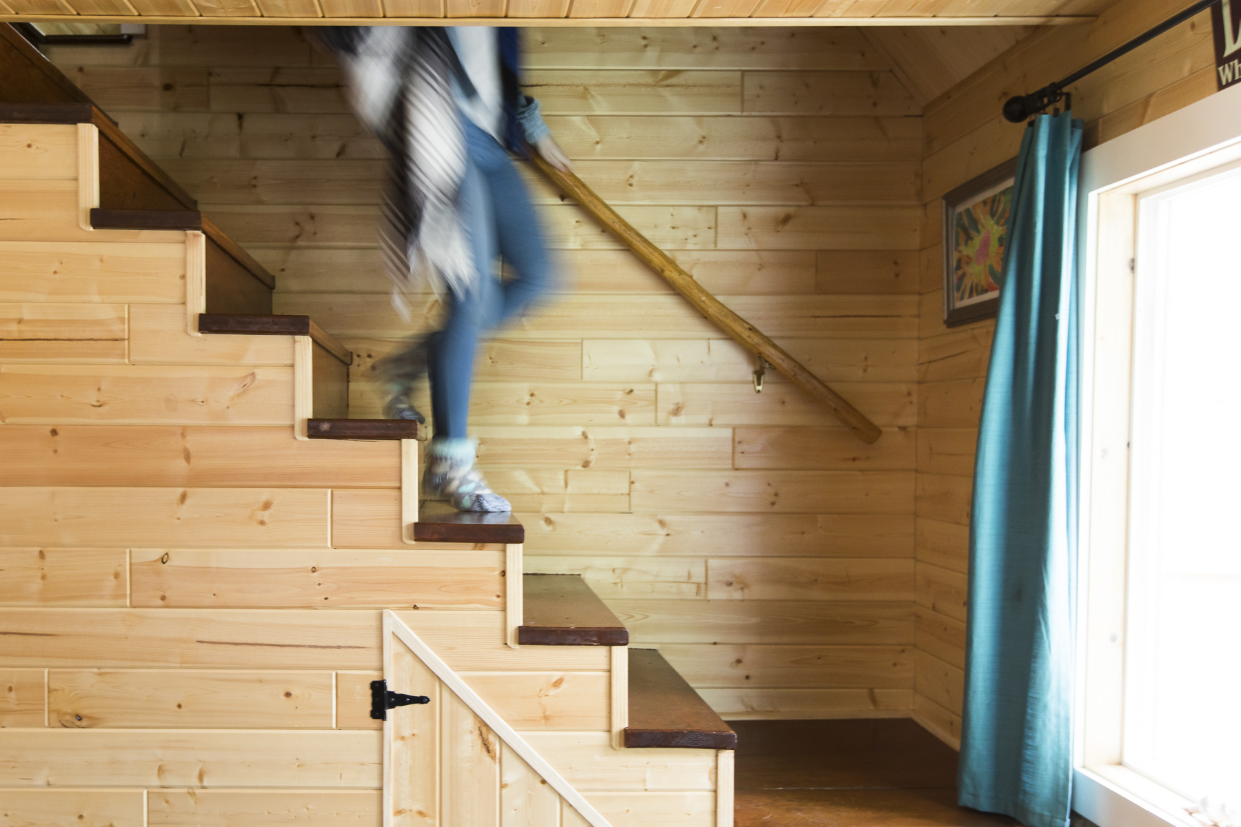 Girl walking down stairs at cabin
