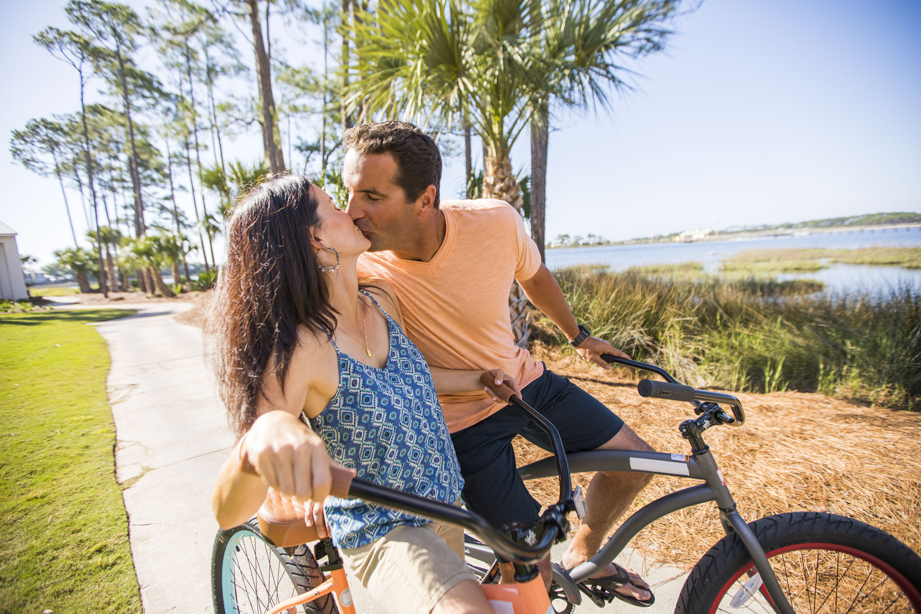 Man and WomanKissing on Bikes