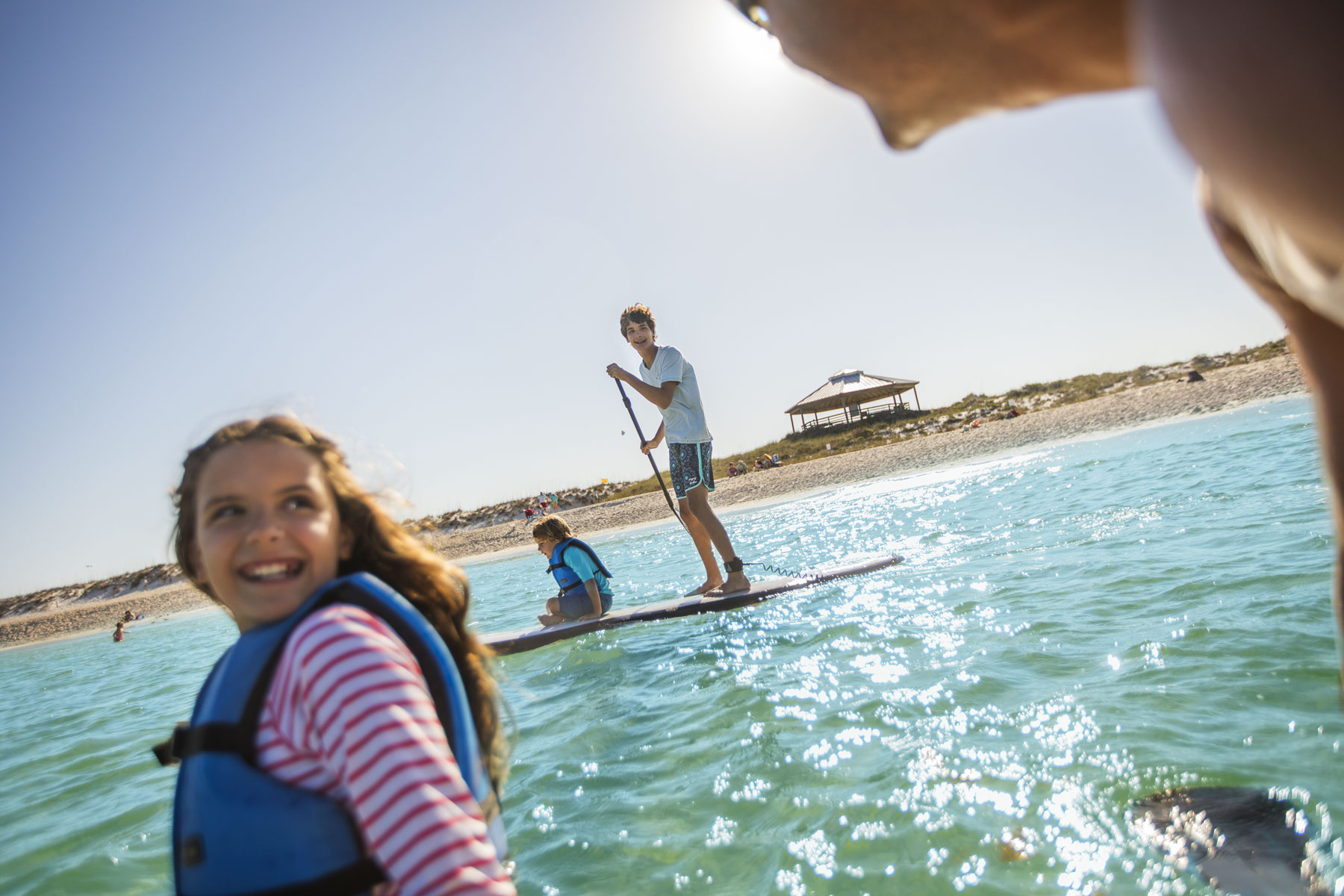 Family Paddle Boarding in Ocean