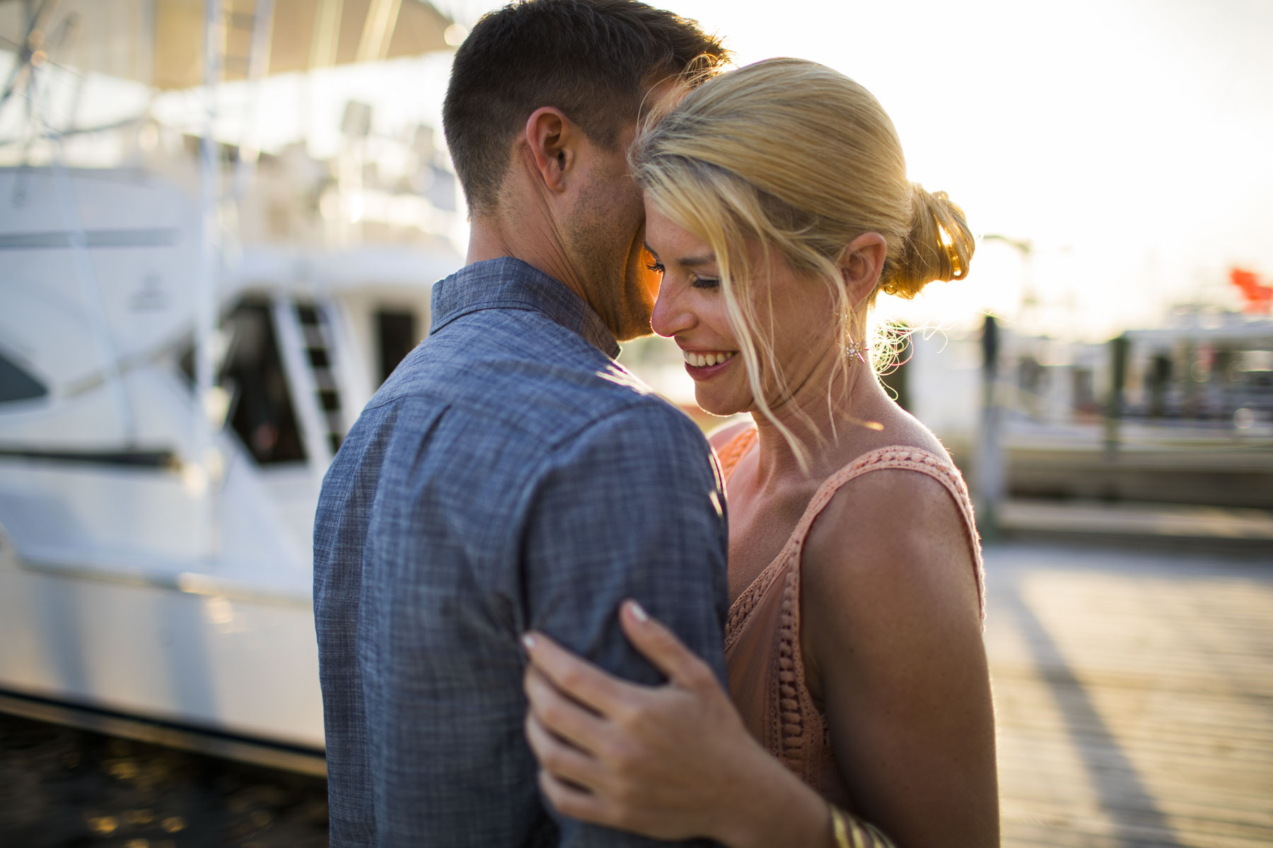 Couple Embracing on Boat Dock