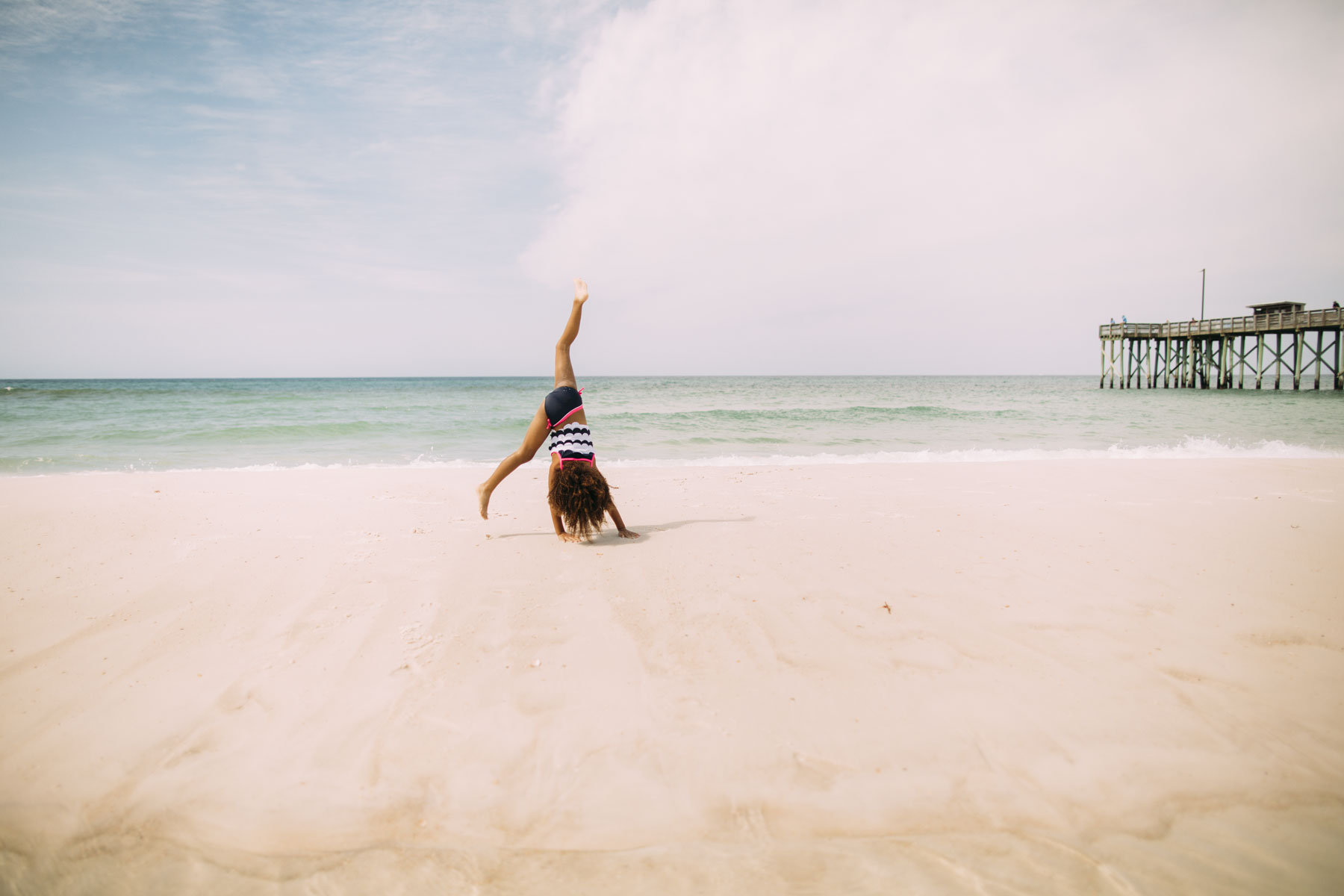 Girl Doing Cartwheels on beach