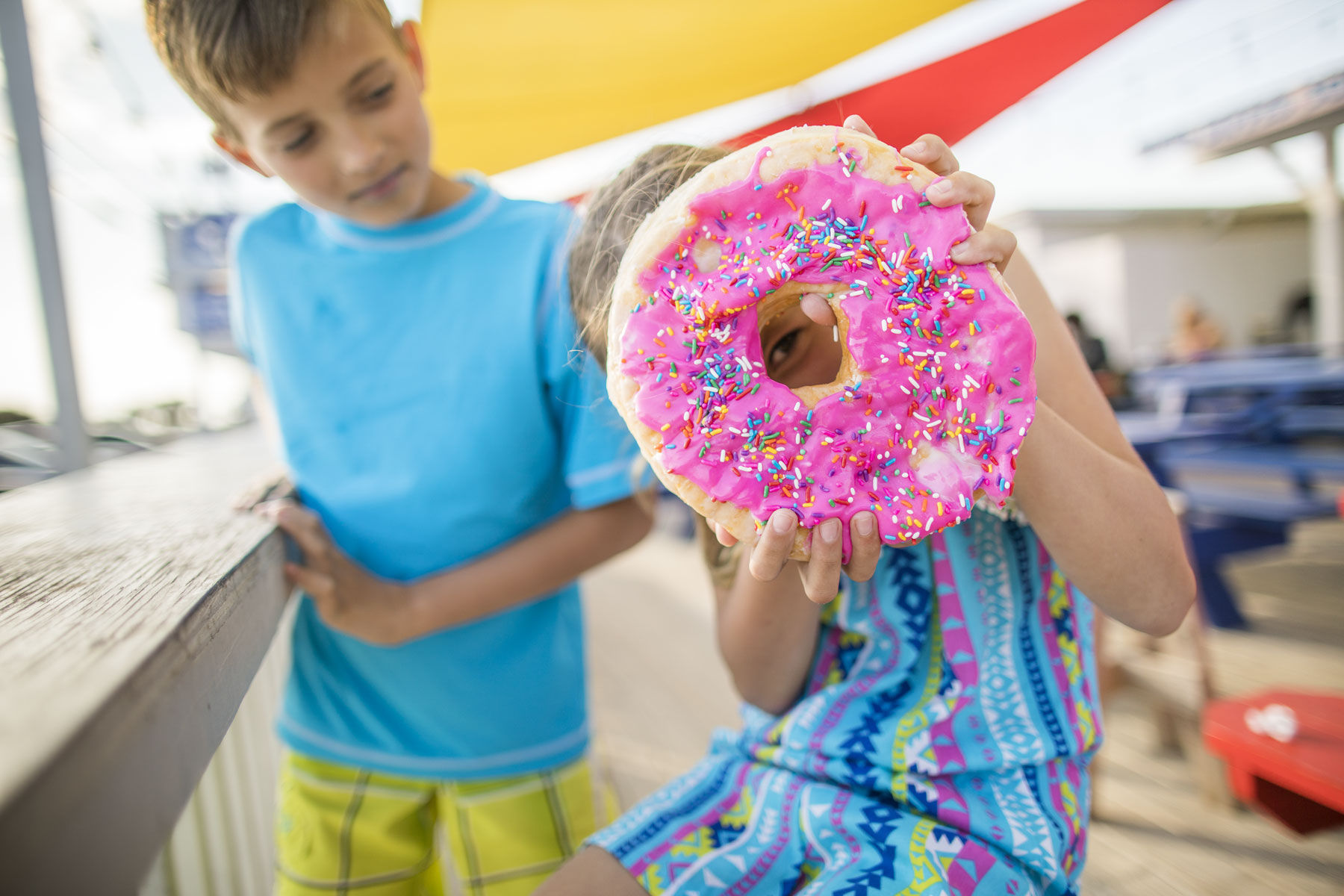 Girl Holding Large Donut