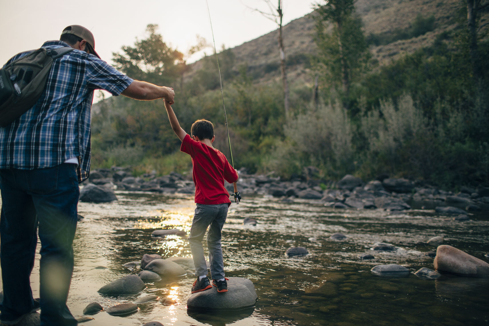 Dad Helping Son In River