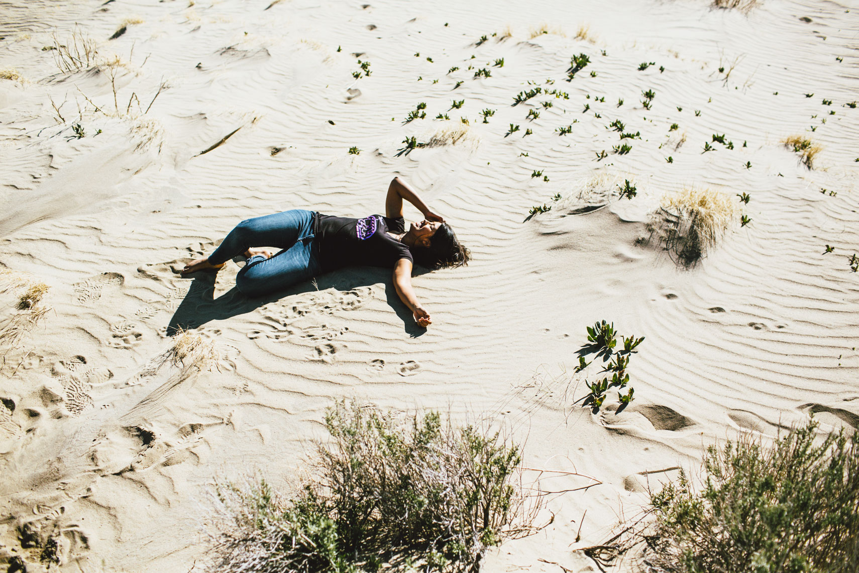 Girl lying in desert