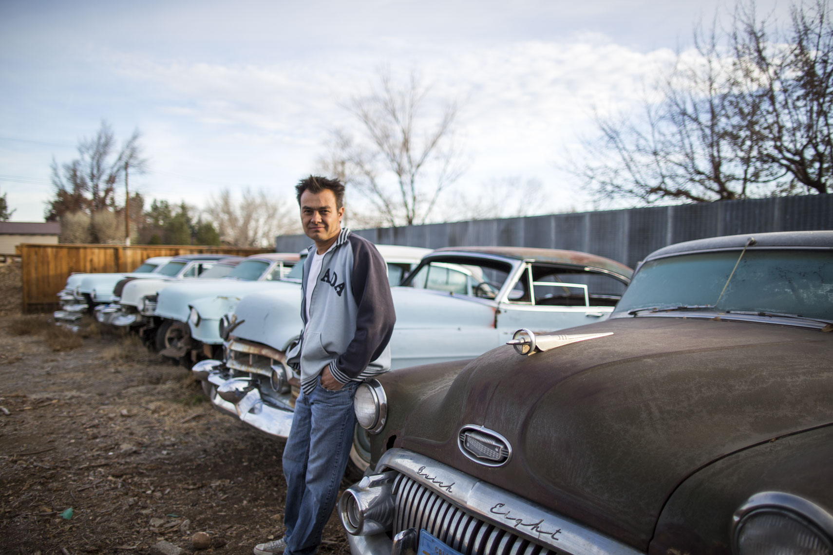 Man leaning on cadillac